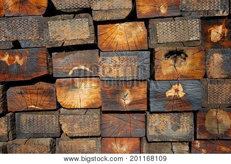 Image of old stacked railway sleepers, closeup view