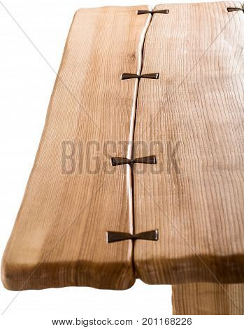 Part of wooden brown antique table isolated on white background. dining square table. Handmade table, furniture. Close-up
