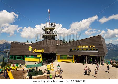 Schladming, Austria - August 15: Tourists In Front Of Planai Bike And Ski Areal On August 15, 2017 I