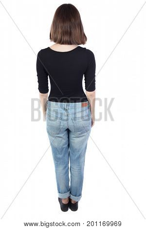 back view of standing young beautiful  woman.  girl  watching. Rear view people collection.  backside view of person. Top view of a girl in a black sweater with her hands down