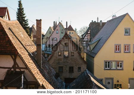 A view of the traditional German houses and roofs in Rothenburg ob der Tauber in Germany. Europe.