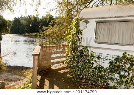 An Old Caravan By The River As A Holiday Home