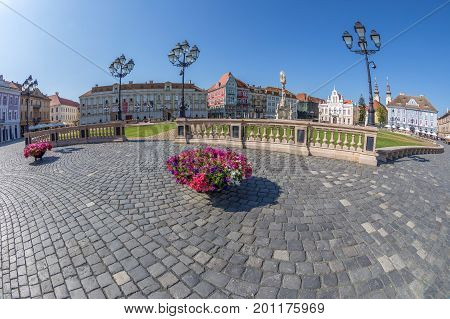 TIMISOARA ROMANIA - AUGUST 24 2017: View of one part at Union Square in Timisoara Romania with old buildings. Trinity Statue and serbian vicariate in background.