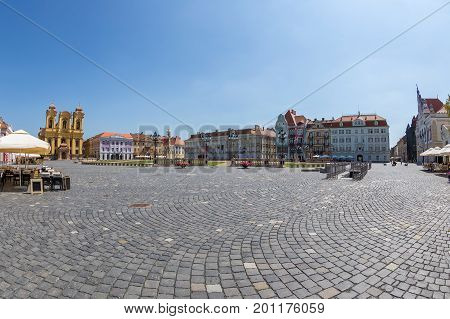 TIMISOARA ROMANIA - AUGUST 24 2017: View of one part at Union Square in Timisoara Romania with old buildings. Trinity Statue german Dom and serbian vicariate in background.