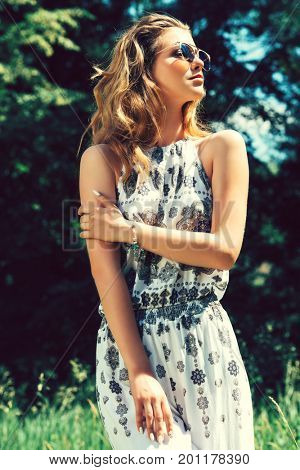 Beautiful young woman in a summer park. Modern hippie, hipster style. Beauty, fashion outdoor.