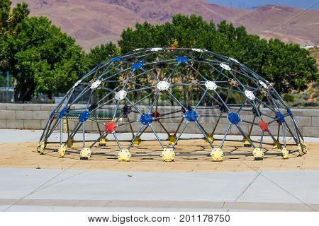Semi Round Geometric Jungle Gym At Children's Playground