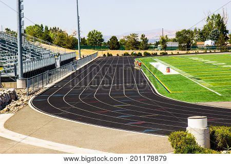 Running Track Between Grand Stand & Playing Field