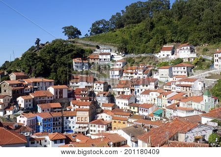 View Of The Hill Full Of Houses In Cudillero Between Trees, Spain