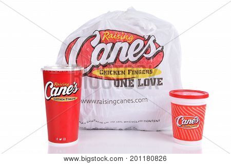 IRVINE CALIFORNIA - AUGUST 22 2017: Raising Canes take out bag. Raising Canes ia a fast food restaurant chain specializing in Chicken Finger meals.