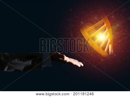 Close of businessman hand presenting DNA molecule research as concept. Mixed media