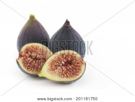 group of ficus carica common fig from the mulberry family whole and sliced isolated on a white background