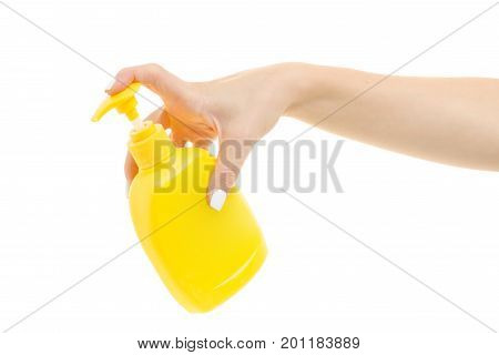 Female hands with a dispenser on a white background isolation