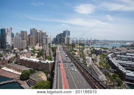 SYDNEY,NSW,AUSTRALIA-NOVEMBER 20,2016: Elevated view over highway traffic with city skyline, harbour and waterfront housing in Sydney, Australia.
