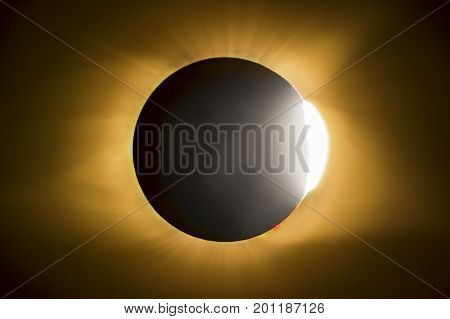 The sun begins to emerge from being totally blocked by the sun producing what has come to be know as the diamond ring. Photographed during the total eclipse on August 21 2017.