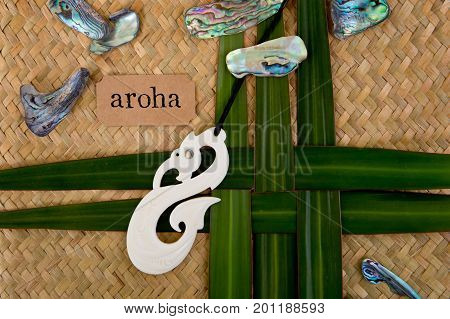 New Zealand - Maori Themed Objects - Carved Bone Pendant On Flax Leaves With Aroha Label (maori For