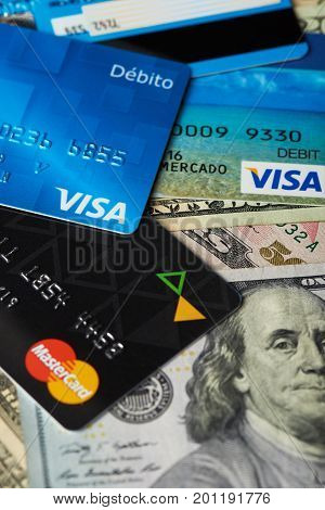 New york, USA - August 24, 2017:Close-up of visa and master card on dollar bill background. Finance banking theme