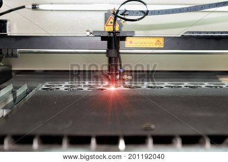 High precision CNC laser cutting metal sheet in factory.