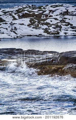 Roaring Ocean Waves on Lofoten Islands Shore Line During Beginning of Spring.Vertical Image