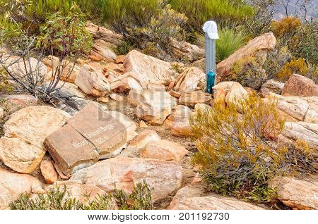 A hat and water are must have items on the top of Mount Ohlssen-Bagge at Wilpena Pound - Flinders Ranges SA Australia