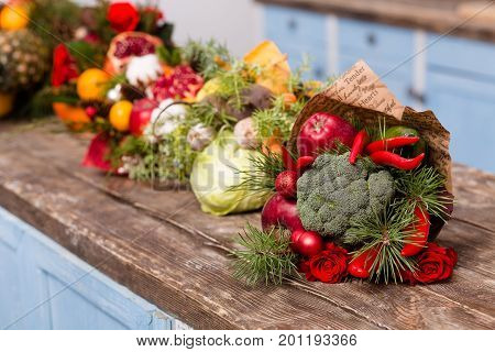 Close up view of bright and colorful eatable bouquets. Seasonable fruits and vrgetables in original compositions.