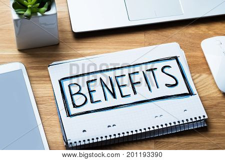 Social Security Benefits Concept In Notepad At Desk