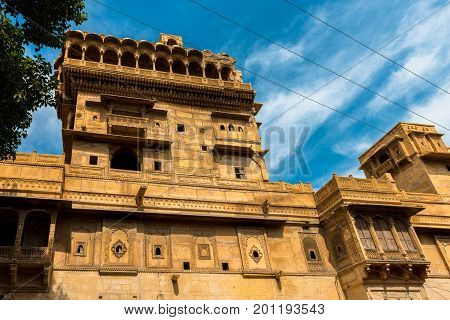 The front of Saalam Singh Ki Haweli carved yellow sandstone architecture in Jaisalmer known as Golden City in India.