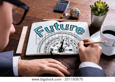 Man Drawing Future And Compass Guidance Concept