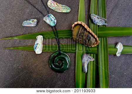 New Zealand - Maori Themed Objects - Tribal River Stone In Woven Basket With Greenstone Pendant Flax