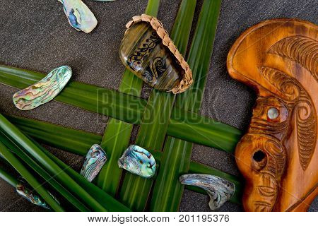 New Zealand - Maori Themed Objects - Tribal River Stone With Green Flax Leaves, Wooden Mere And Abal