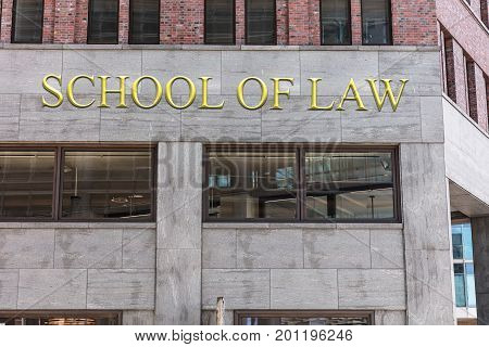 Low angle view of school of law sign on building in city
