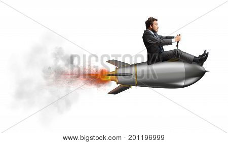 Businessman flying over a fast rocket. concept of company startup