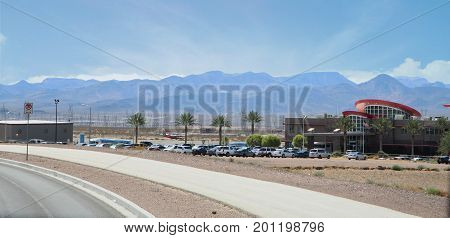 BOULDER CITY, NEVADA--Air Tour Terminal airport in Boulder City, Nevada, with the Nevada mountains in the far distance. Photo taken in August 2015.