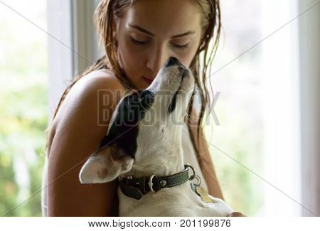 Girl and dog. Girl and dog true love pet portrait photography, affection to dogs. Closeup portrait of beautiful young girl and her beautiful dog.Young happy with long blonde hair hugging dog in her arms showing affection and loyalty intimate peaceful port