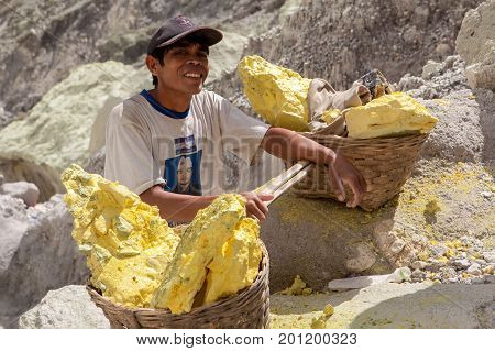 Java/indonesia - May 8, 2015: Sulfur Miner In Ijen Volcano Crater At Java Island In Indonesia.