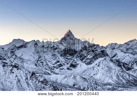 Beautiful Ama Dablam Peak Lit By The Very First Ray Of Morning Sun. Sharp Mountain Peak Standing Out