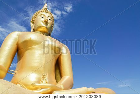 close up outdoor big gold buddha image in temple for people respect