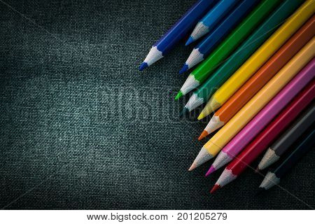 Crayon on black fabric background, Crayon Backdrop.