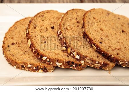 Brown Multigrain Bread Slices On A White Plate