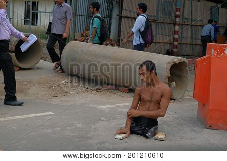 Dhaka, bangladesh, august 2017-a street beggar with out leg on street located at bonani resudential area in dhaka in bangladeshtaken on 24, august 2017