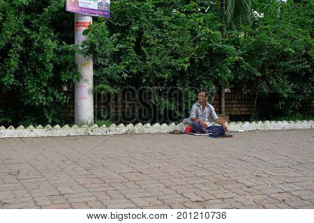 Dhaka, bangladesh, august 2017-a blind street beggar sitting on foothpath located at bonani resudential area in dhaka in bangladeshtaken on 24, august 2017