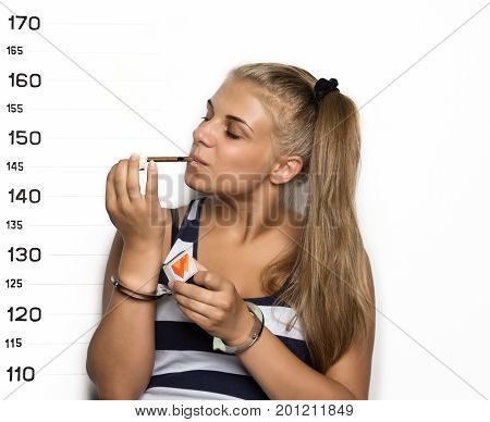Young beautiful blonde woman with sigarette, Criminal Mug Shots.