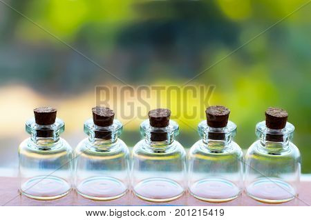 A set of small glass jars nature background