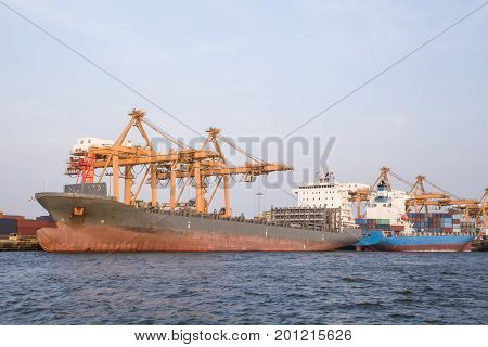 Logistic conceptContainer cargo ship docking port for loading containers from the ship.
