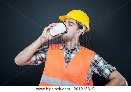 Constructor Wearing Equipment Sipping Takeaway Coffee