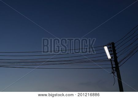 Street Lamp On Electricity Post With Dark Night Sky