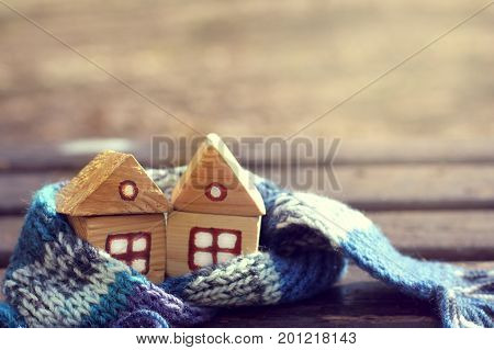 pair of wooden houses wrapped in a scarf comfortably overwintered / Warming meeting of spring