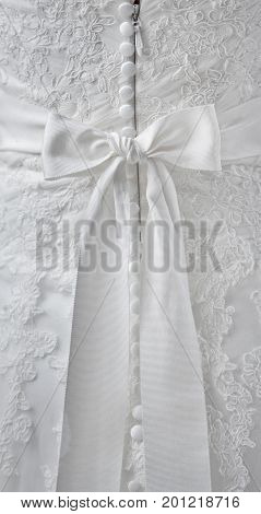 Gorgeous, beautiful, stunning wedding dress belt tied a bow on the back, behind. Clasp with buttons.