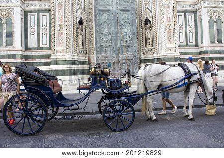 FLORENCE, ITALY - JULY 25, 2017: Calesse in Piazza del Duomo of Santa Maria del Fiore - Tuscany