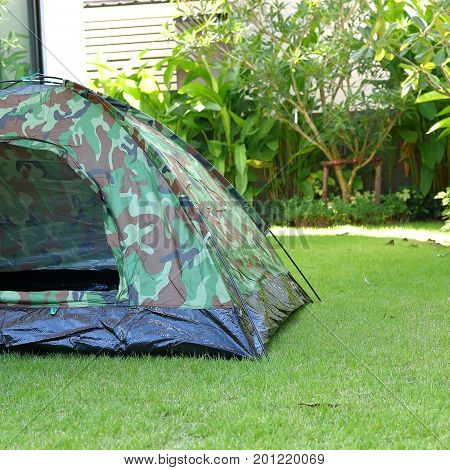 Tent Camping On Green Grass Field Campground, Equipment For Trip Backpack Journey Travel In Nature