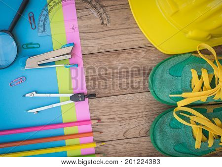 Sneakers, Construction Helmet, Writing Material And Other On Wooden Plank.